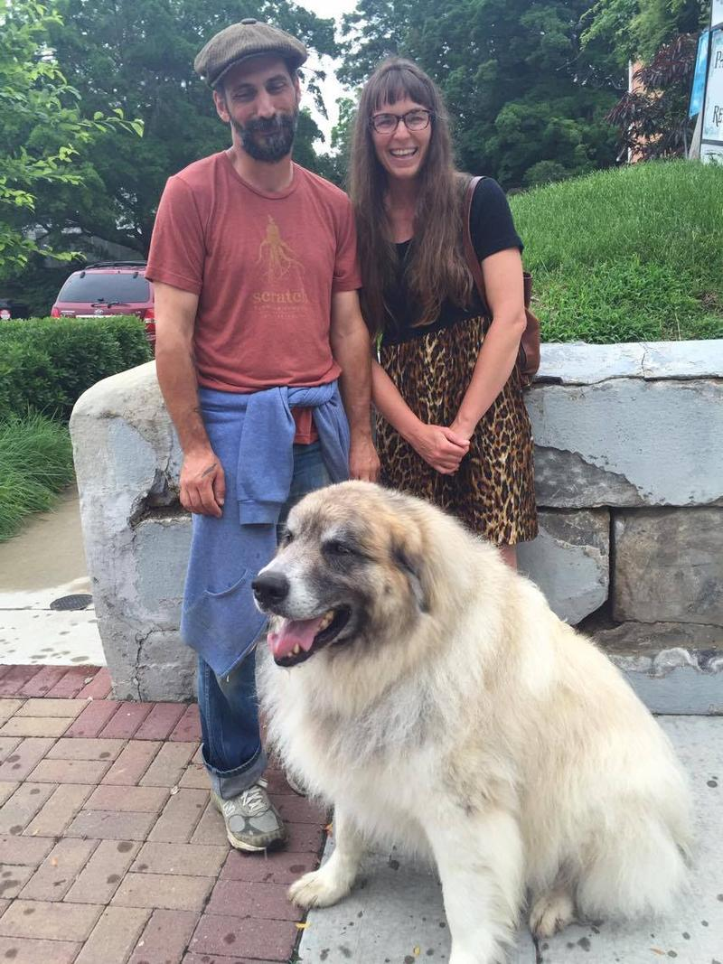 Ross Peterson, left, and Emily Scifers, right, say they came out to see the art. Gusto  was one of many dogs strolling down the main drag of Broadway for Pets Night Out during First Friday with the Arts.