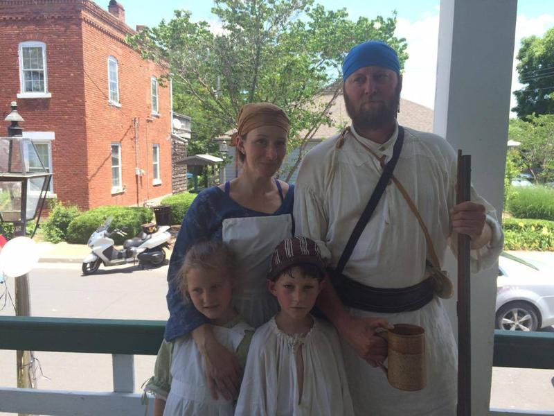 Michael Snyder, back right, and his family wore traditional French clothing in celebration of their French heritage.