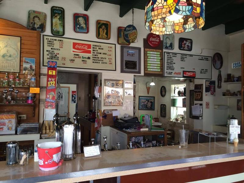 From top to bottom, Sara's Ice Cream is decked out in vintage Coca-Cola memorabilia.