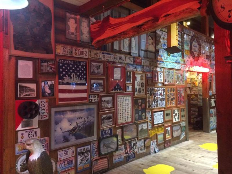 From top to bottom, the walls of Lambert's are embellished with pictures and license plates of different states around the country.