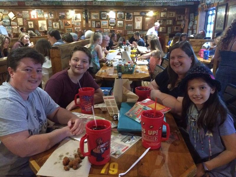 Alex Carter, back left, and Jordan Carter, front right, came all the way from Memphis to enjoy Lambert's famous hot rolls.
