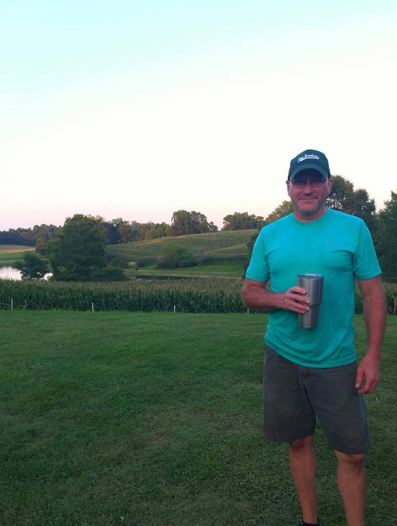 Chris Grojean, proprietor of the Grojean hamburger stand, enjoys the sunset after a weekend of hard work.