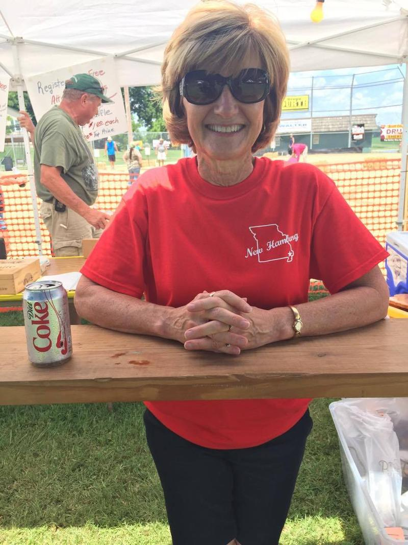 Dorothy Deason works the raffle stand and sound booth at the New Hamburg Picnic.