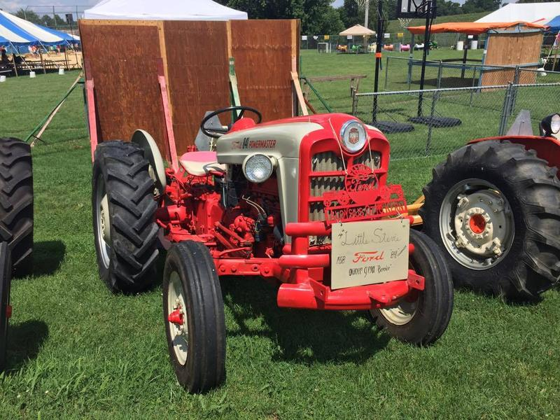 Farmers show off their vintage tractors.