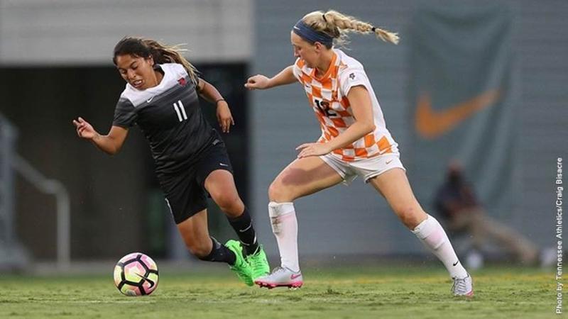 Esmeralda Gonzales (left) in action on the field.