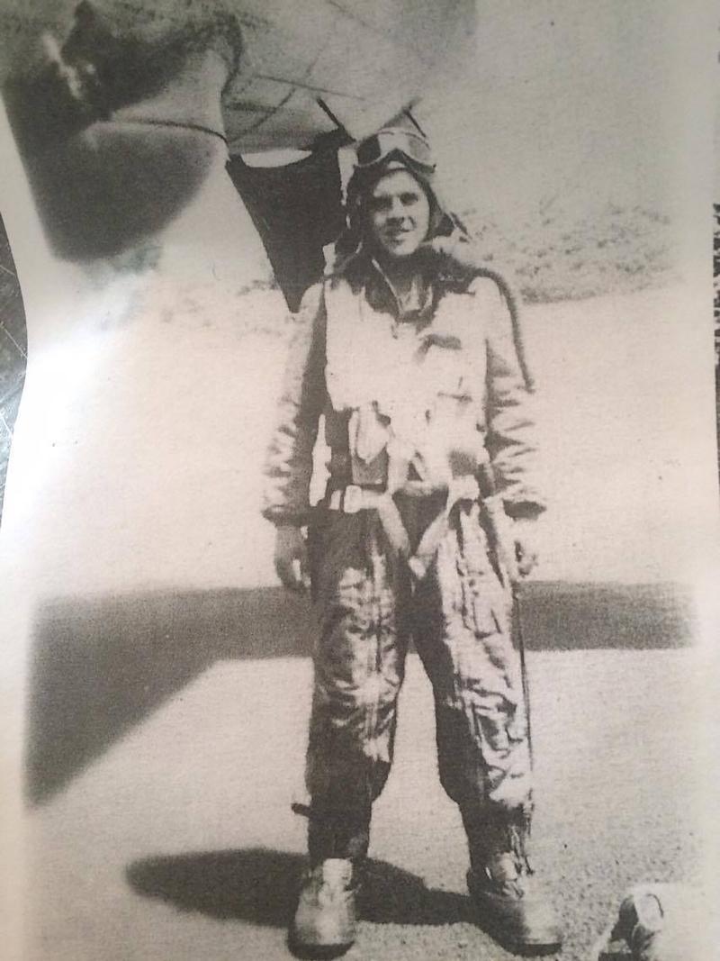 Staff Sgt. John Dragoni stands next to a plane.