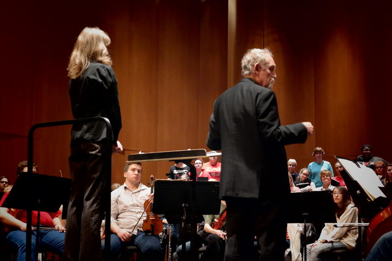 Dr. Sara Edgerton and Dr. Goodwin work with the choir and orchestra at a dress rehearsal Monday night.