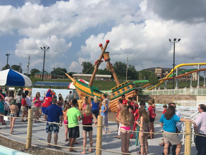 "Visitors gather to celebrate the grand opening of the newest Cape Splash attraction, ""Shipwreck Island."""