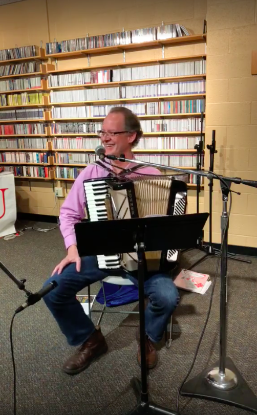 Dr. Christopher Goeke performs a short jingle during Caffe Concerto.