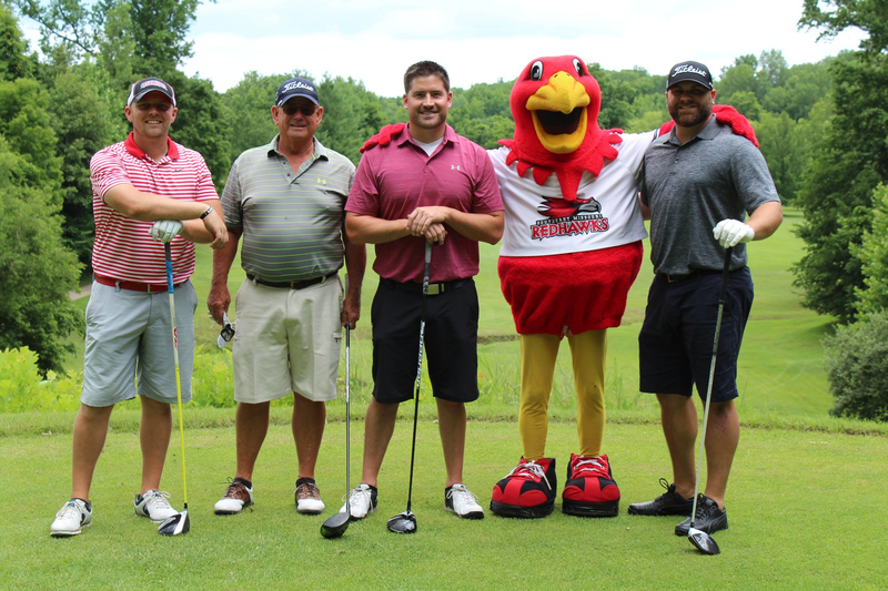 The winning team in the afternoon flight poses with Rowdy at the Cape Girardeau Country Club, from left to right: Brandon Cooper, Glen Harter, Dr. Nick Harter, Nick Martin.