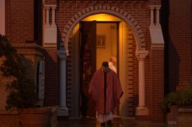 A Lafayette priest, the Rev. Kevin Bordelon, rushes out of St. John's Cathedral after a rainy Sunday evening mass.