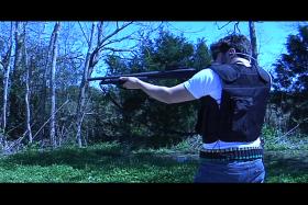 Ryan Albrado, gun enthusiast, practicing shooting skills.