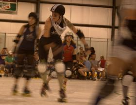 Maezilla Stomphonya dashes around the track during the Acadiana Roller Girl's March 23 victory.