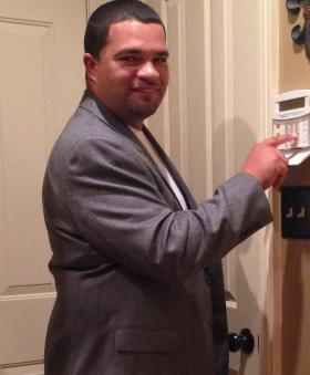 Chad Guillory setting his Five Star home security system which he is used to and has had for numerous years.