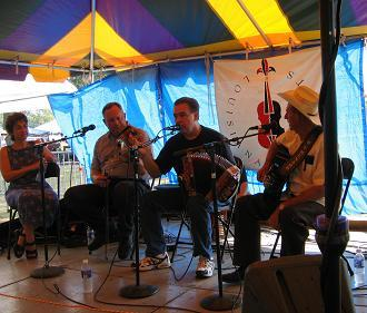 Accordion player Bruce Daigrepont at the Festivals Acadiens in Lafayette. Pictured left to right are Amanda Lefleur, Terry Huval, Bruce Daigrepont and D.L. Menard.