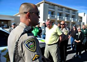 During a simulation, Deputy Dason Allen, left, and Deputy David Lucero demonstrate the fundamentals of proper arrest procedures as part of a recent Citizen's Academy at the Doña Ana County Sheriff's Department.