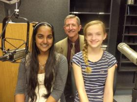 Indumati Roychowdhury and Mikayla Smelker, both winners of the 2011 Hey, Mozart! New Mexico Child Composer Project, with orchestrator Dr. Greg Fant