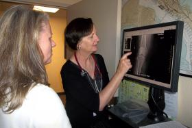 Dr. Judi Voelz looking at an x-ray.
