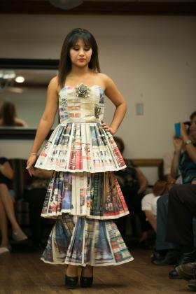 NMSU student models a dress made out of newspaper during the Clothing, Textiles and Fashion Merchandising program fashion show on April 26. (submitted photo)