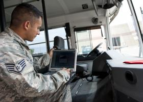 Staff Sgt. Mario Garcia, 49th Logistics Readiness Squadron vehicle maintenance technician, uses a computer to set up an automatic vehicle idling program at Holloman Air Force Base N.M., July 19. The automatic idling system helped lower harmful emissions from some of the larger diesel vehicles in the LRS fleet at Holloman. (U.S. Air Force photo by Airman 1st Class Daniel E. Liddicoet/Released)