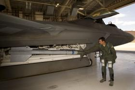 1st Lt. Stephen Renner, 7th Fighter Squadron F-22 Raptor pilot, examines the maintenance order on the aircraft before flight at Holloman Air Force Base, N.M., July 25. The F-22's sophisticated aerodesign, advanced flight controls, thrust vectoring, and high thrust-to-weight ratio provide it the capability to outmaneuver other fighter aircraft. (U.S. Air Force photo by Senior Airman Kasey Close/Released)