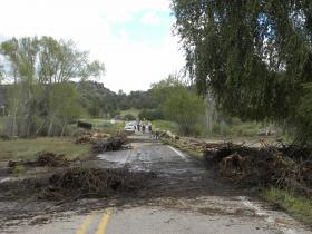 Crews remove debris near the Gila Cliff Dwellings visitor center.  Floods affected roads in the area, where part of NM 15 remains closed.