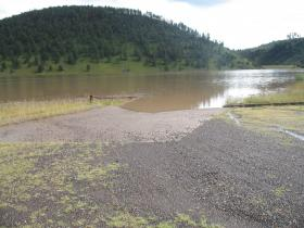 Snow Lake Road under water from recent floods.