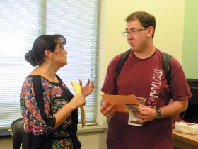 Counseling and Educational Psychology interim department head Elsa Arroyos talks with sophomore Alejandro Castaneda about the newly-created bachelor's of science in counseling and community psychology degree at an open house, Oct. 1, in O'Donnell Hall at New Mexico State University. (NMSU photo by Tiffany Acosta)