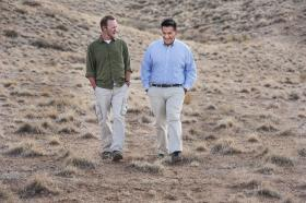 Jason Shelton, left, and John Bailon reminisce while walking in terrain at Sandia National Laboratories that reminds them of Iraq. They both fought for the U.S. military in Operation Iraqi Freedom. (Photo by Randy Montoya)