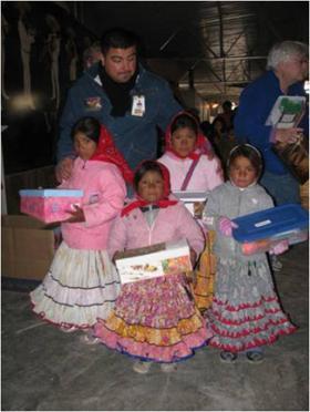 Tarahumara girls receive Christmas Shoe Box filled with gifts.