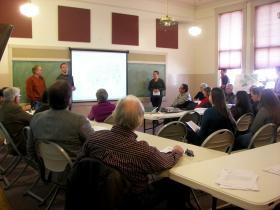 Students from NMSU Professor Jon Hunner's historic preservation class present the results of their preliminary survey to the community of Mesilla Park. Their goal is to nominate the neighborhood as a historic district on the New Mexico Register of Culture Properties and the National Register of Historic Places. (Photo by Isabel Rodriguez)