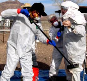 Participants in a cascading events full-scale exercise practice proper de-contamination procedures. Multiple New Mexico governmental agencies participated in the exercise to improve response time to a real life situation. (NMSU photo by Jane Moorman)
