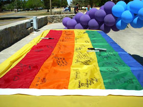 The symbolic rainbow flag gets signed by students in support of GLBTQ Week (Photo provided by Tara Melton)