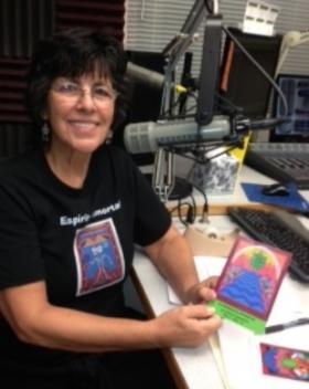 Corina Gabaldón at KRWG FM studios with her artwork.