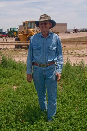 Robert Flynn, New Mexico State University agronomist, in 2009 when the NuMex Bill Melton alfalfa variety was released. This variety is drought-tolerant and was created by Ian Ray, NMSU professor of agronomy.