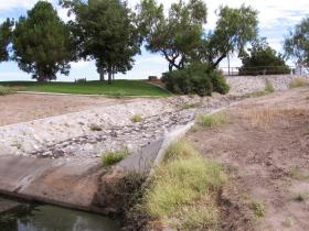 Much of the landscape design on the NMSU campus was created to manage storm runoff. From swales to cuts in curbs, it all serves a purpose – moving storm water away from buildings and to areas where it can absorb into the ground. (Courtesy photo)