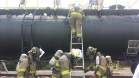 Las Cruces Fire Department hazardous materials technicians mitigate a railcar chemical leak scenario during the 18th Annual Los Alamos National Laboratories Hazmat Challenge.
