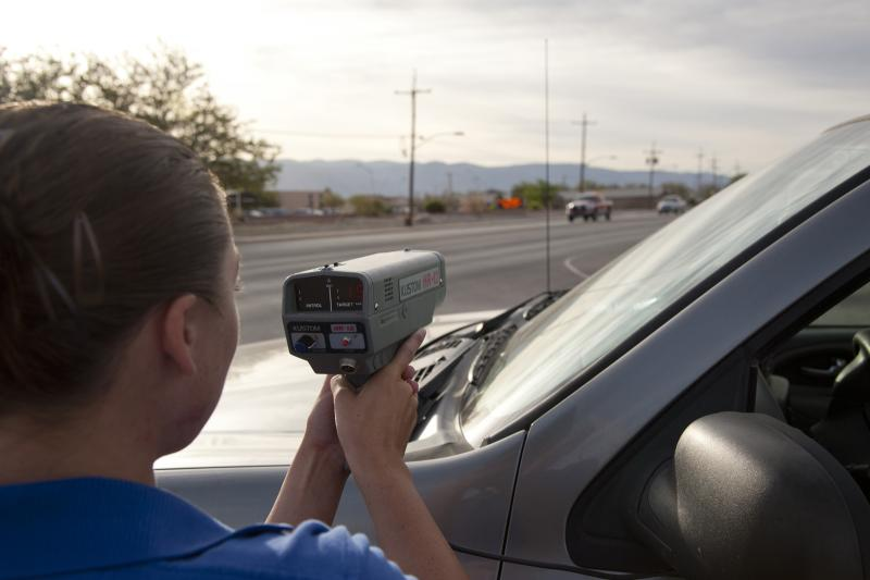 Airmen 1st Class Jessica Herb, 49th Security Forces Squadron, community police officer, uses the radar gun in the school zone April 13.