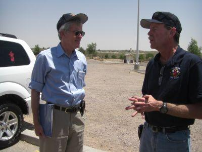 Senator Bingaman is briefed by the BLM's Steve Bumgarner