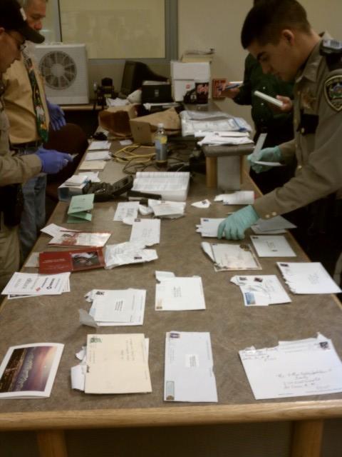Investigators sort through stolen mail.