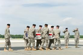 A U.S. Army carry team transfers the remains of Army Staff Sgt. Israel P. Nuanes, of Las Cruces, N.M., at Dover Air Force Base, Del., May 15, 2012. Nuanes was assigned to the 741st Ordnance Company, EOD, Fort Bliss, Texas. (U.S. Air Force photo)