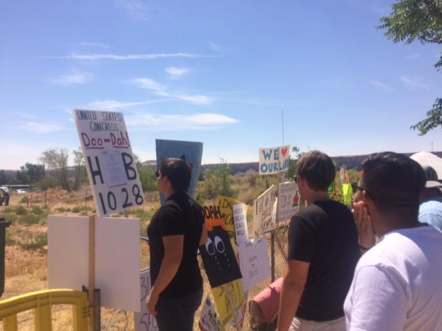 Signs outside the Bluff Community Center on Saturday illustrated the diverse range of views towards the Bears Ears Monument proposal
