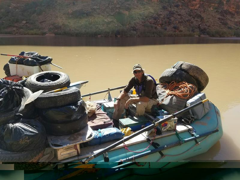 Tim Hunter on his boat with a load of trash from the San Juan River