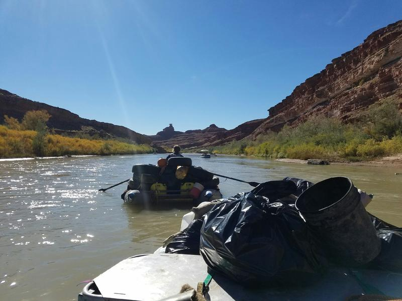 Boaters hauling trash down the San Juan River
