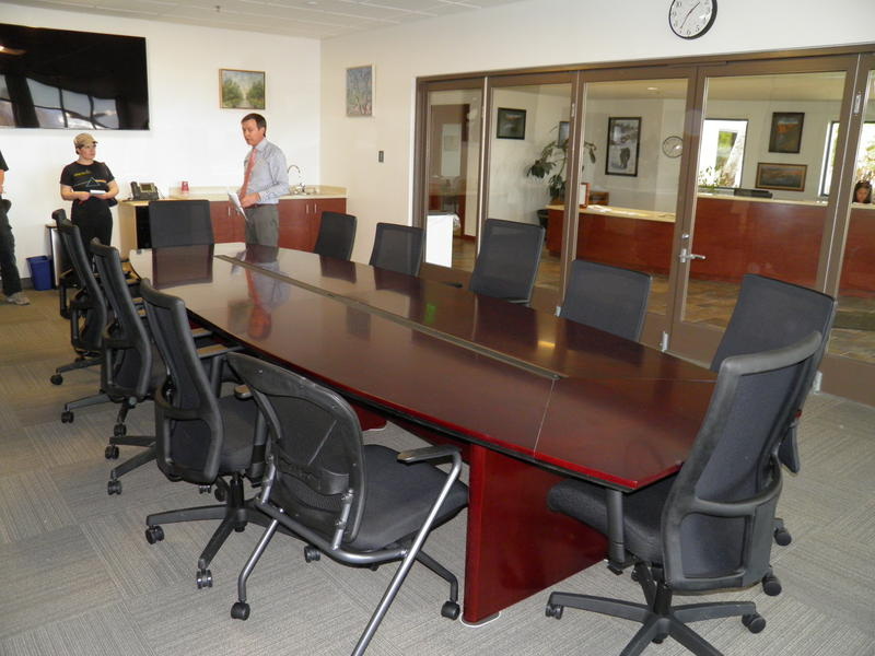 """City officials tour the meeting room at the new Cortez City Hall. Local artists are critical of the City's decision to """"lend"""" space to artists, calling it a form of economic discrimination"""