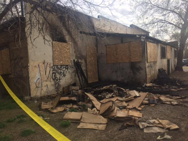 This photo taken in March shows damage to the back side of the Harp Building, where officials say the fire started.