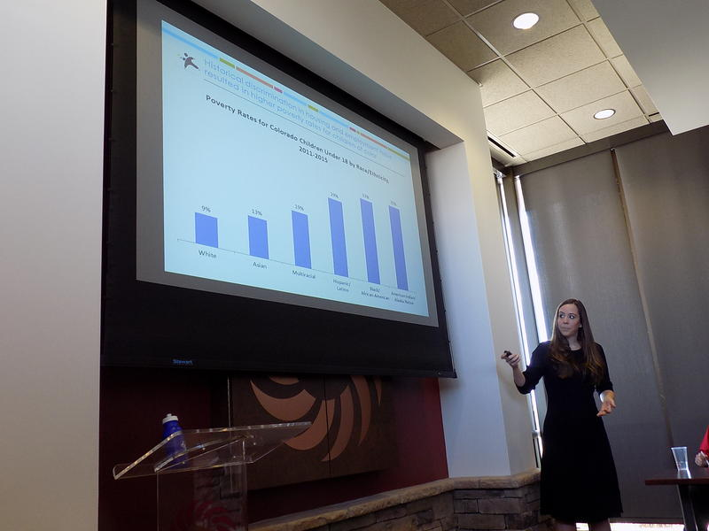 "Sarah Hughes with the Colorado Children's Campaign presents results of the 2016-2017 ""Kids Count"" data to community leaders Monday"