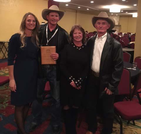 Suckla, flanked by his wife and parents, poses with his award at the Colorado Counties Incorporated annual meeting in Colorado Springs last week.