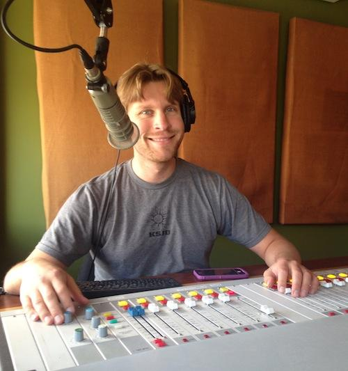 Austin at the control board of the KSJD studio