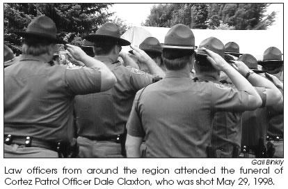 An archived photo and caption of a 1998 memorial for Officer Dale Claxton, shared courtesy of the Four Corners Free Press